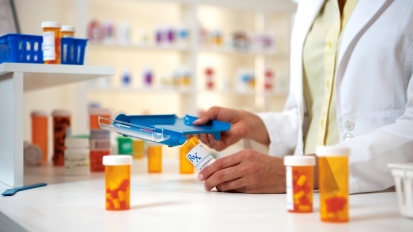 A pharmacist filling a perscription.