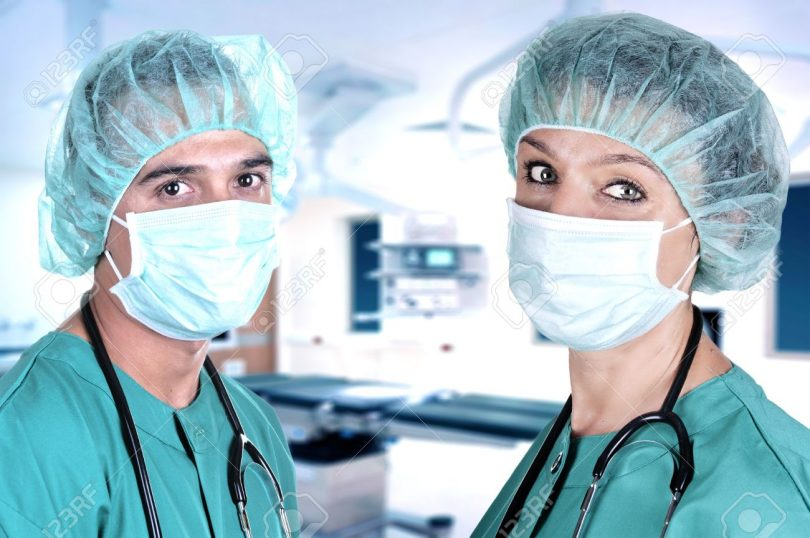 14470158-male-and-female-surgeons-in-the-operating-room